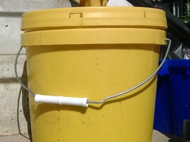 Yellow bucket used for the composting program.