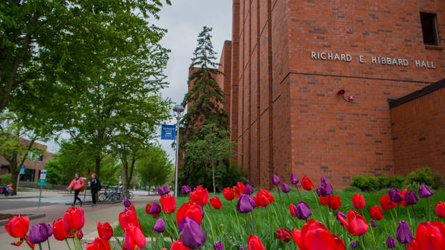 Hibbard Hall on a spring day with tulips blooming.