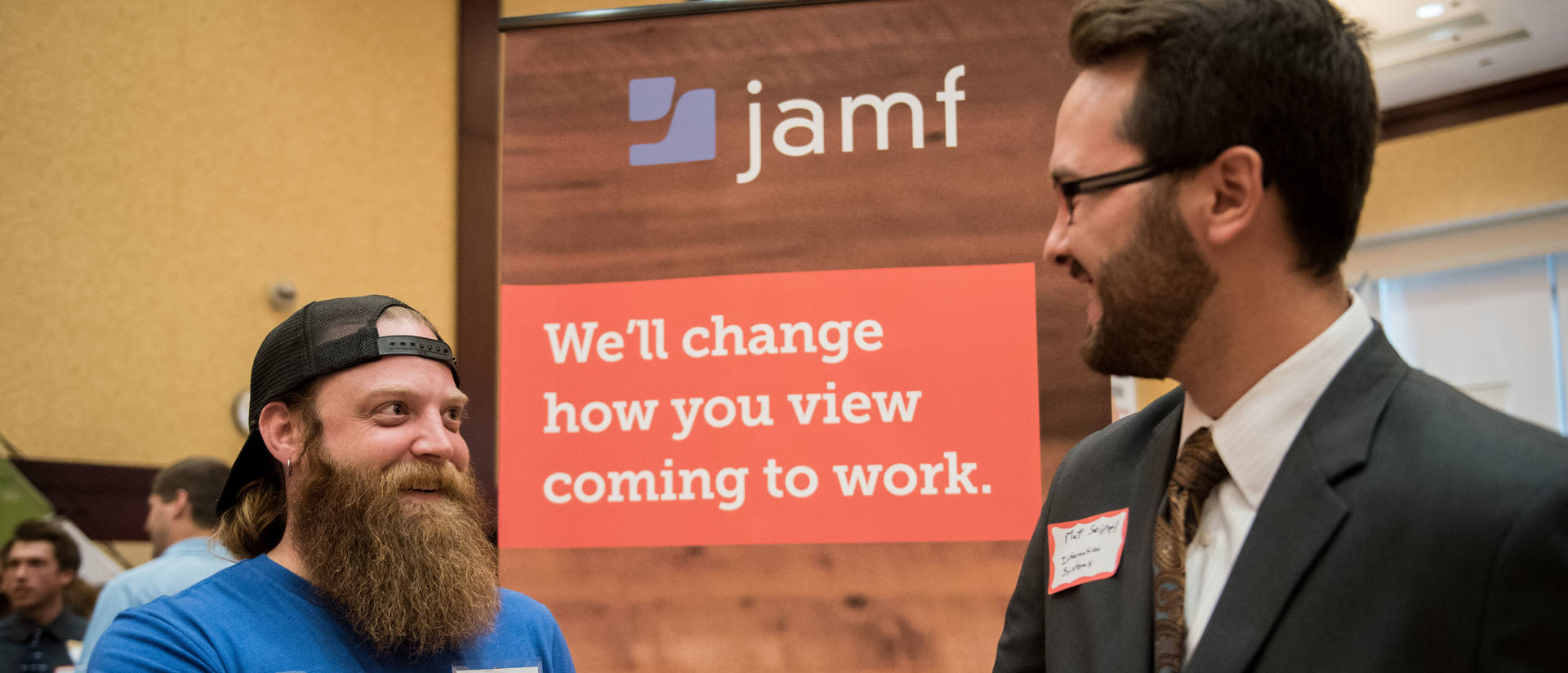 Jamf employee talking to make student at Career Conference