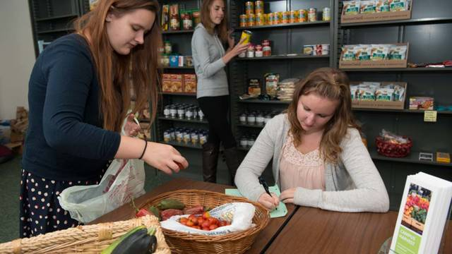 Female staff in Campus Harvest food pantry