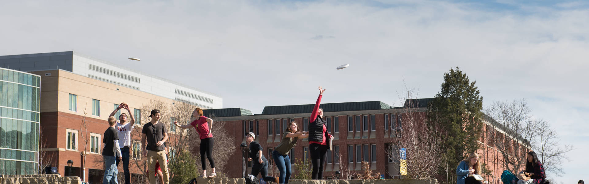 Students playing Frisbee in the campus mall