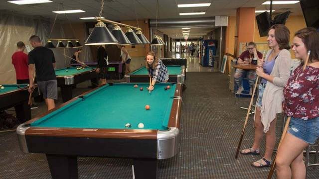 Students playing pool in the Hilltop Billiards Center