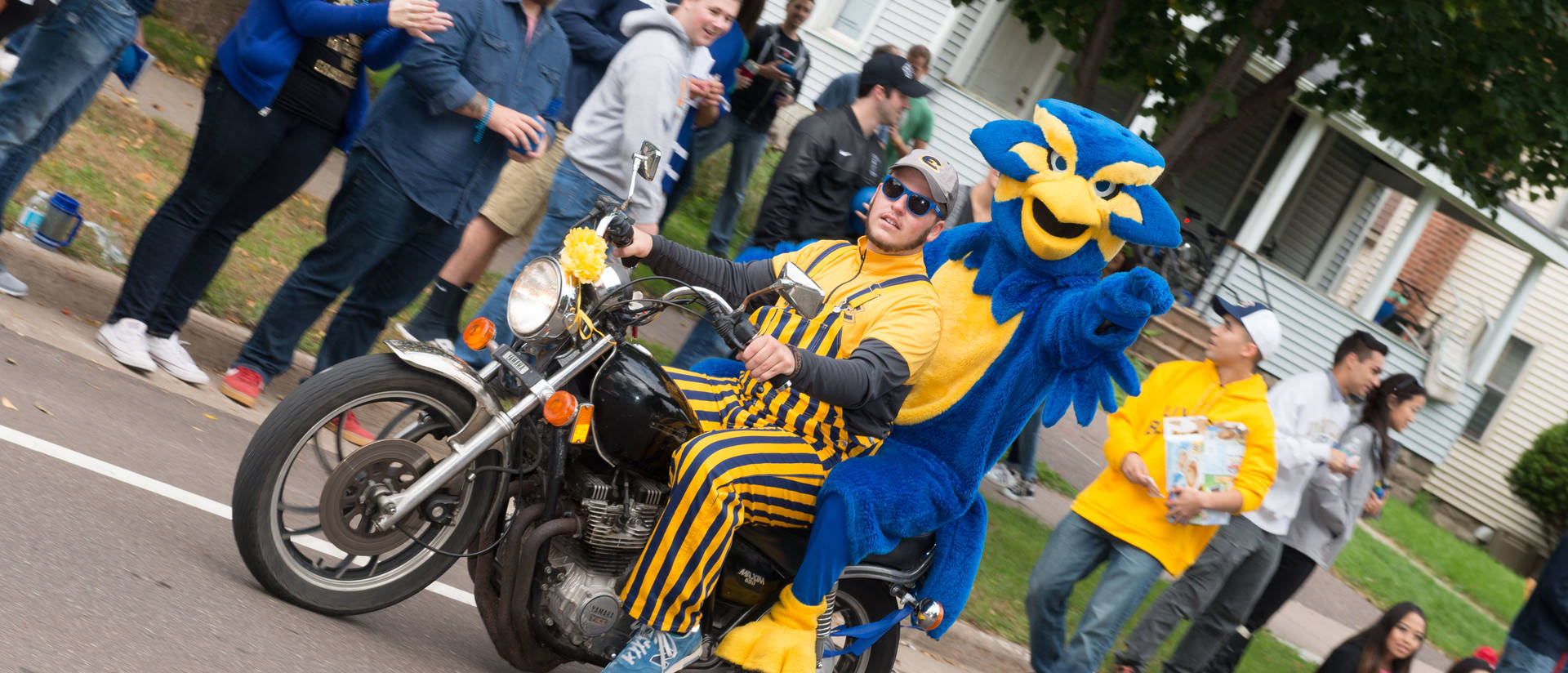 Homecoming Parade, Blu on a motorcycle
