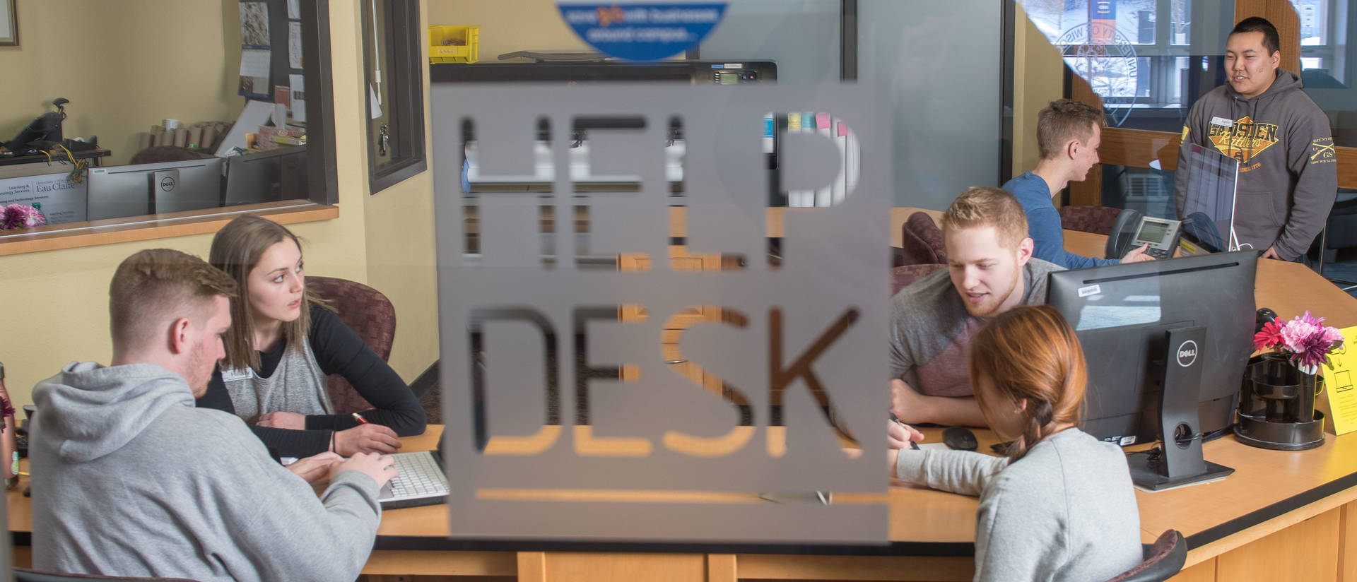 Students working at the help desk in LTS