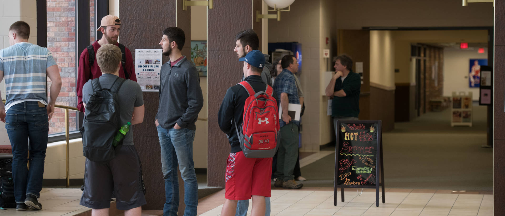 Students gathered in hallway of Ritzinger Hall in UW-Barron County