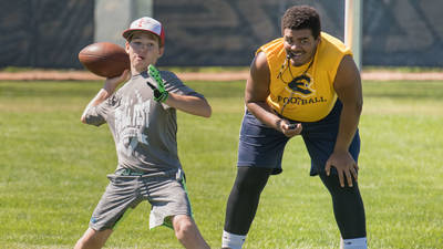 Football youth camper and student coach