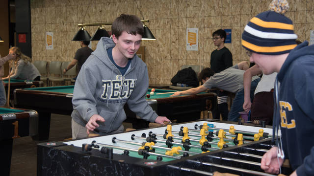 Students playing pool at The Lookout.