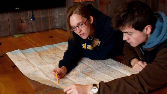 Students looking at map