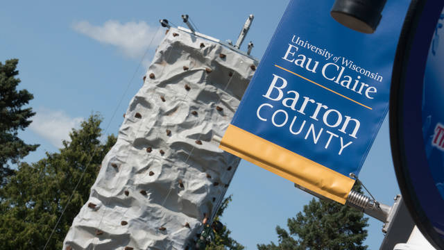Climbing wall and UWEC-BC flag