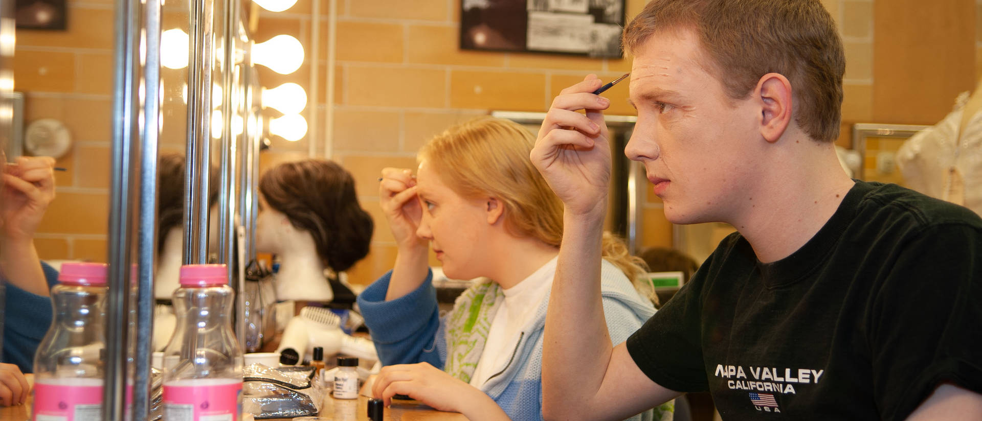 Two students applying stage make-up