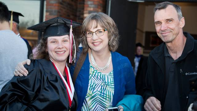 UW-Eau Claire – Barron County gradaute and her parents at commencement