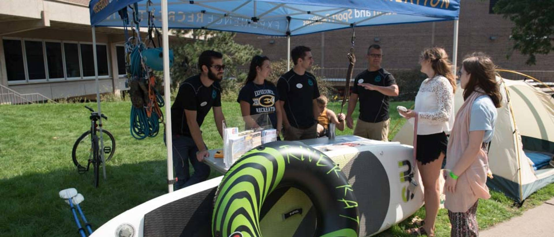 UWEC Students staffing tent at 2017 Tour-de-Rec event