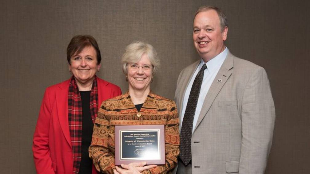 The Office of Research and Sponsored Program's Dr. Karen Havholm, Assistant Vice Chancellor (middle), with Provost Patricia Kleine (left) and Chancellor Dr. James Schmidt (right).