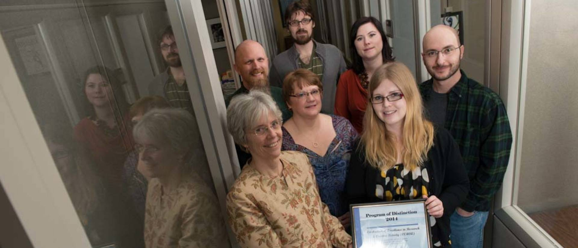 (left to right, front row), Karen Havholm, Ann Statz, business manager, Carissa Beckwith, office assistant, Chris Zimmerman, graduate assistant (left to right, back row), Jeremy Miner, Erik Williams, graduate assistant, Heather Johnson-Schmitz