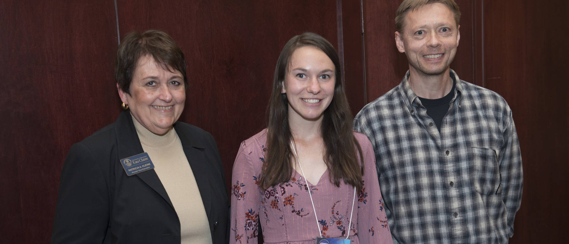 Honorable Mention Eryn Mares (middle) with mentor Dan Herman and Provost Kleine.