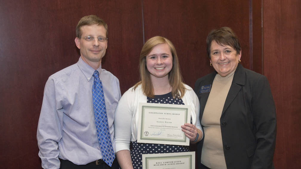 Scholarship recipient Allison Welter (middle) with mentor Derek Gingerich and Provost Kleine.