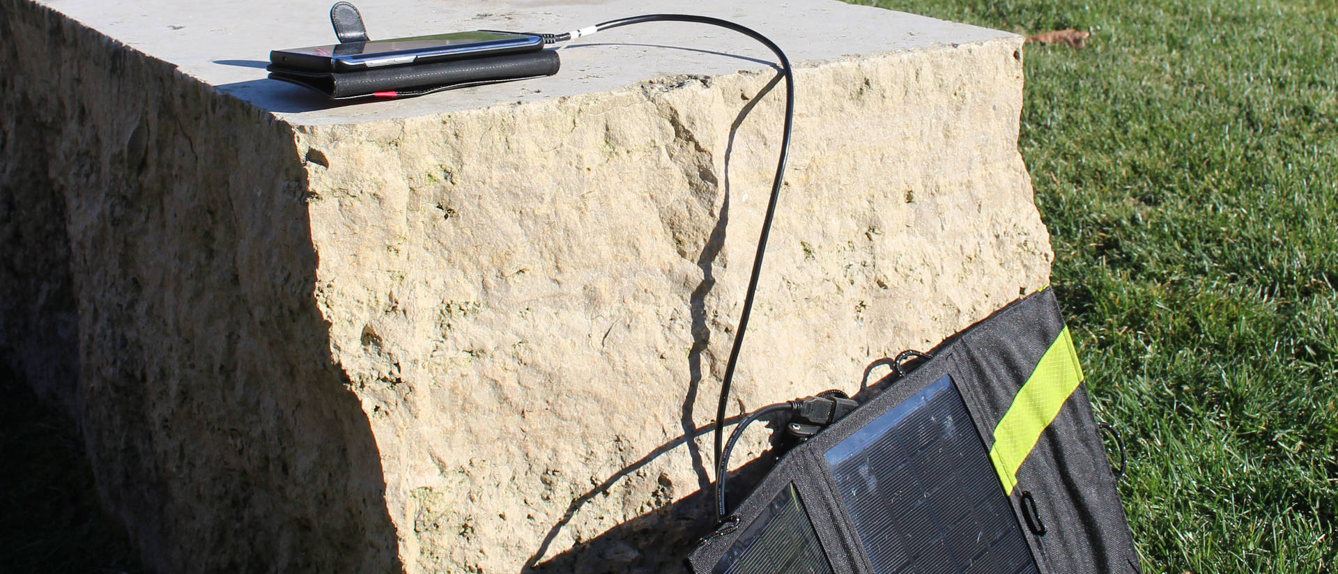 Solar charger connected to tablet