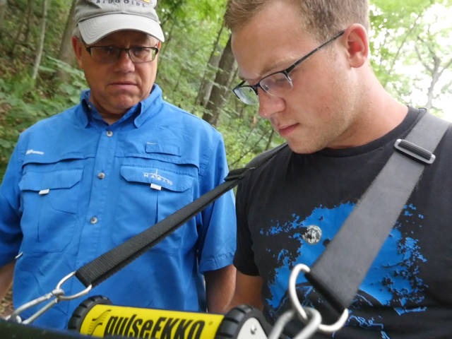 Dr. Harry Jol in the field with student