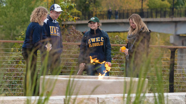 UW-Eau Claire students around firepit at Chippewa River Terrace
