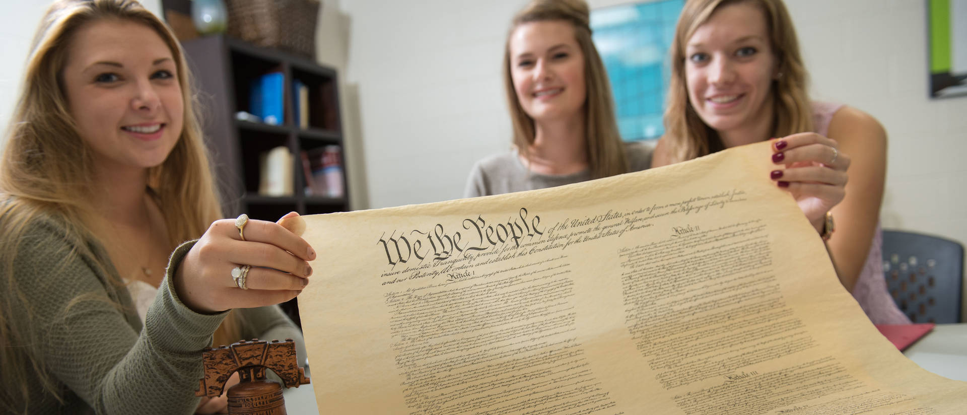 Political science students studying the constitution