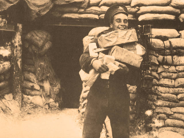 WWI soldier during Christmas Eve Truce of 1914, holding packages, gifts