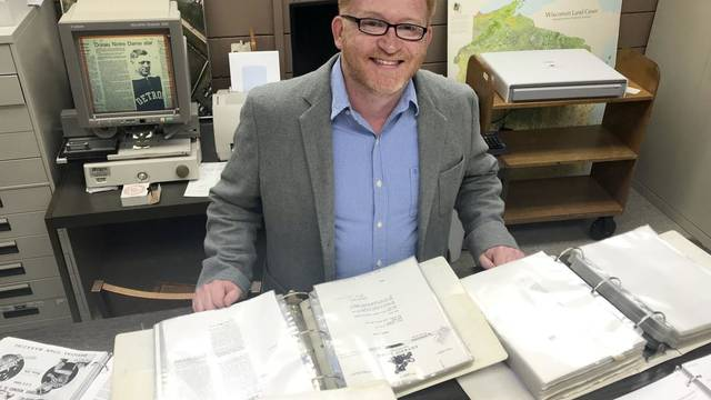 Local Author Joe Neise with some of his research materials