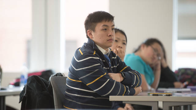 Students listen to guest speaker who is a shaman in the HUMS 110: Hmong Civilization class.