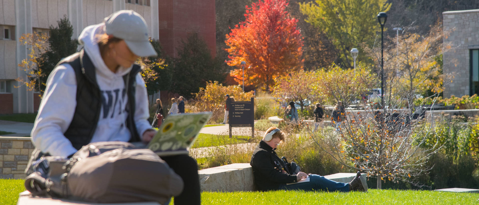 UW-Eau Claire students study and relax on lower campus on a warm fall day.