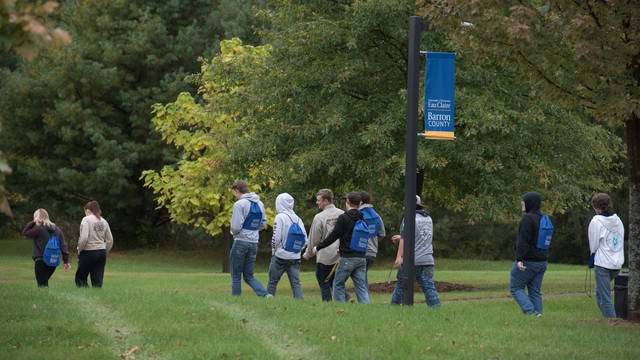 UW-Eau Claire – Barron County students walk outside across campus on a fall day.