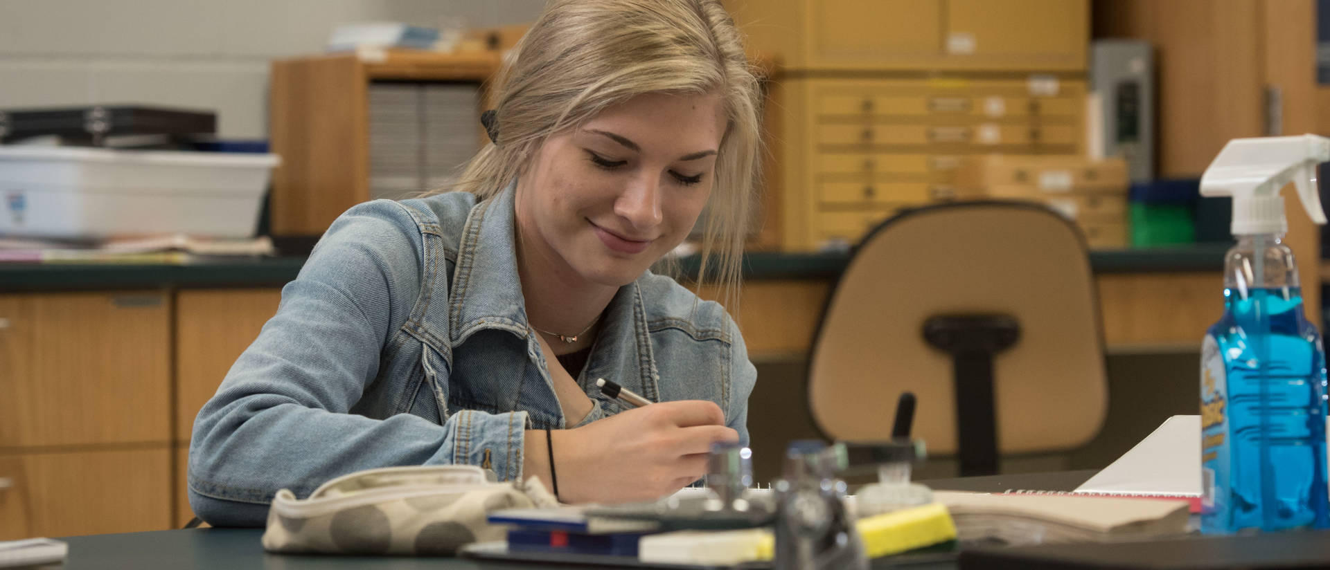 UW-Eau Claire – Barron County student takes note during science lab.
