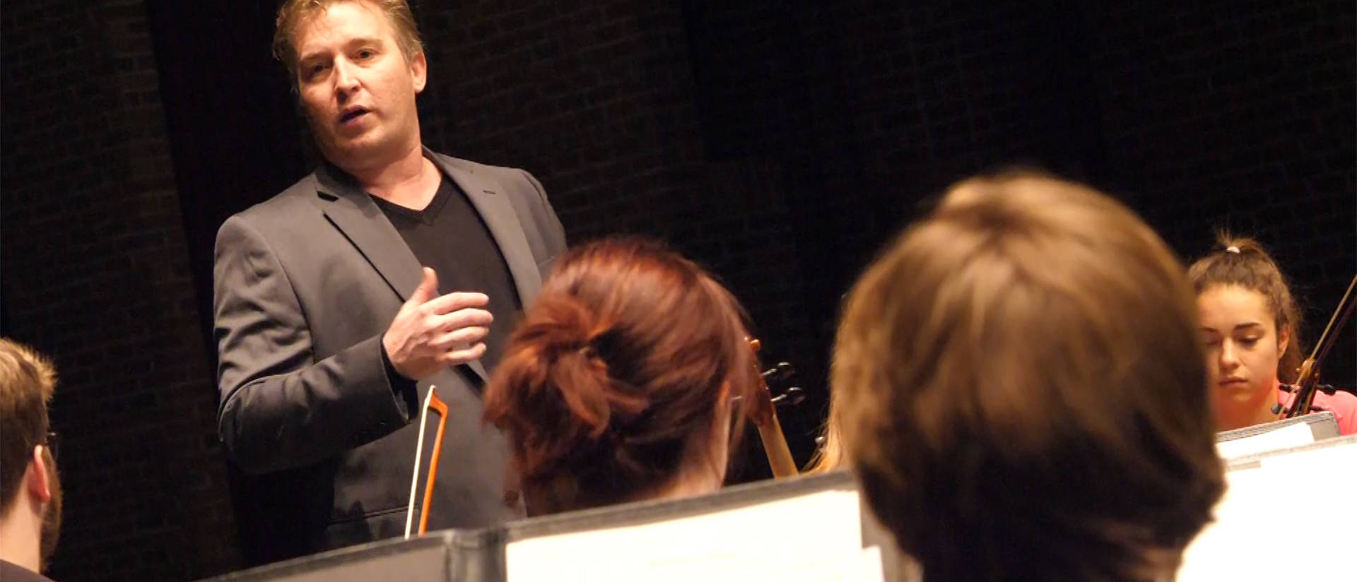 Kyle Newmaster rehearsing Holiday Concert