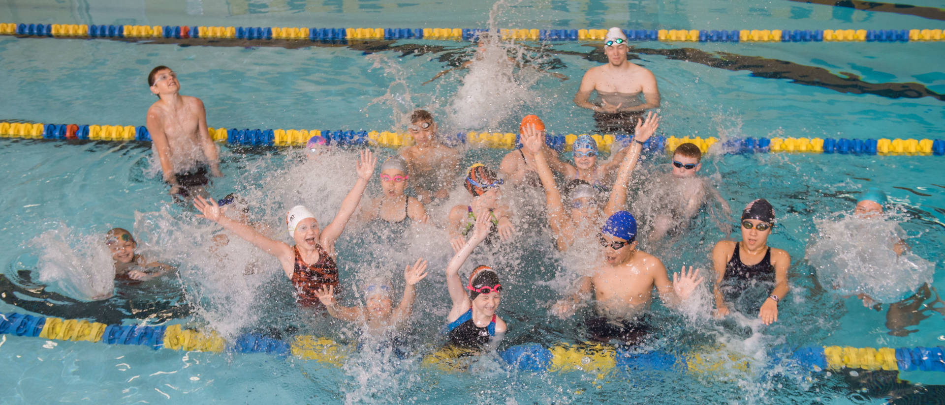 UWEC Swim Camp Participants Splash in Pool