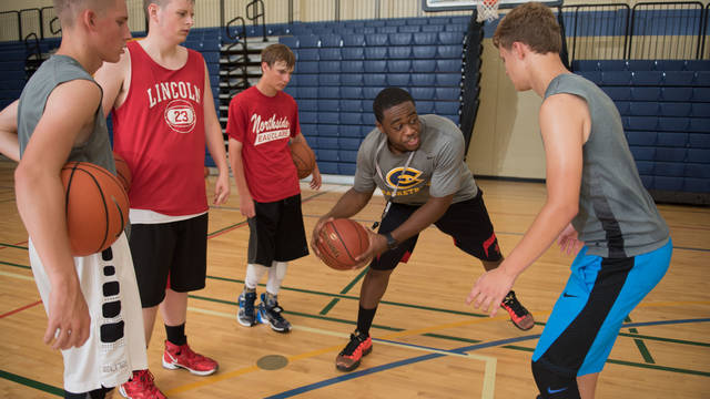 UWEC Boys Basketball Camp Participants Learn Drill