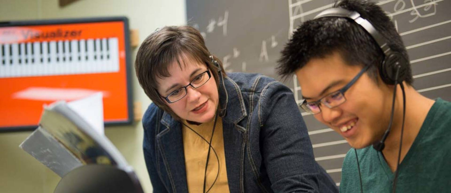UW-Eau Claire music major student collaborates with faculty on the piano.