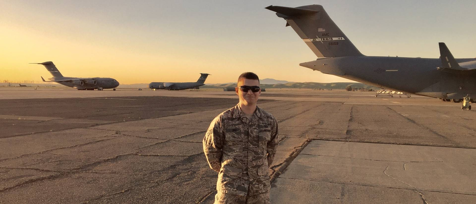 Senior Tyler Bee on the tarmak with Air Force planes