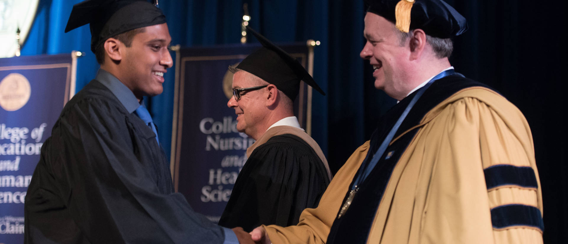 UW-Eau Claire grad shakes hands with chancellor on commencement stage