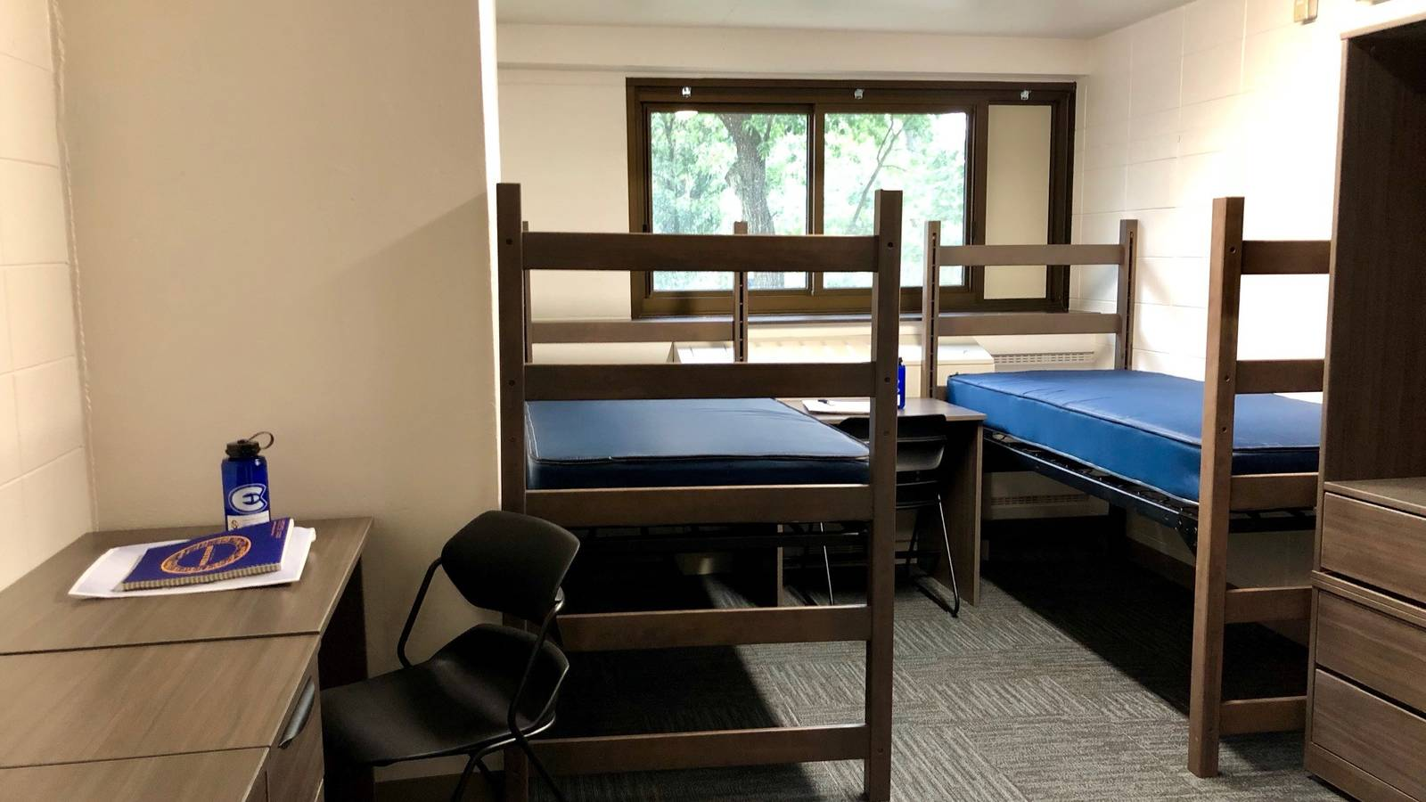 Each room includes two beds, desks and wardrobes