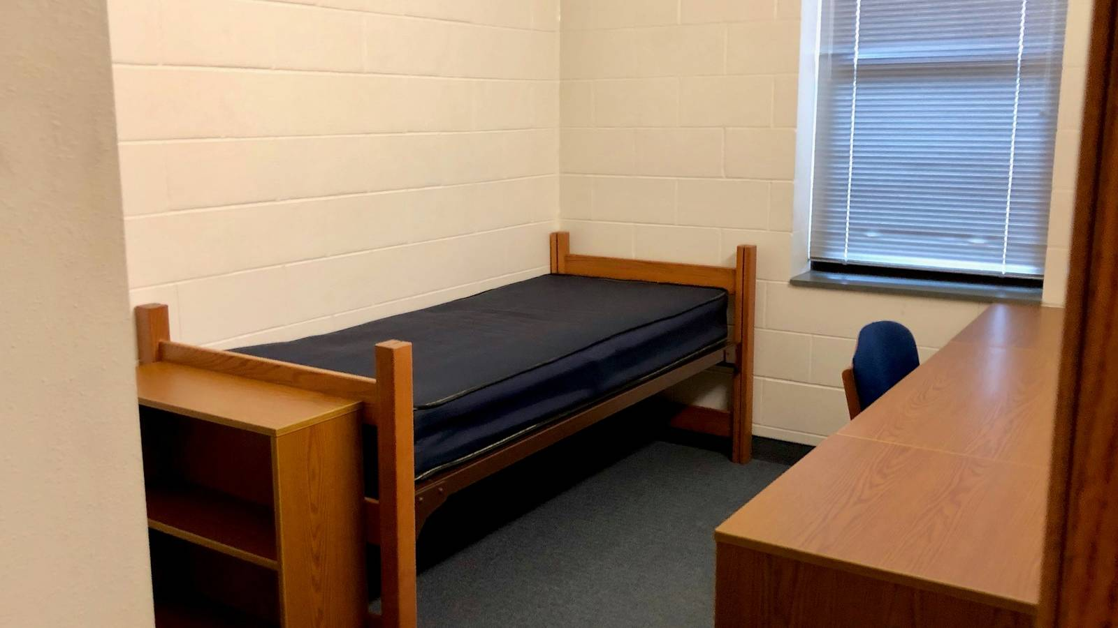 A standard single bedroom in Chancellors Hall
