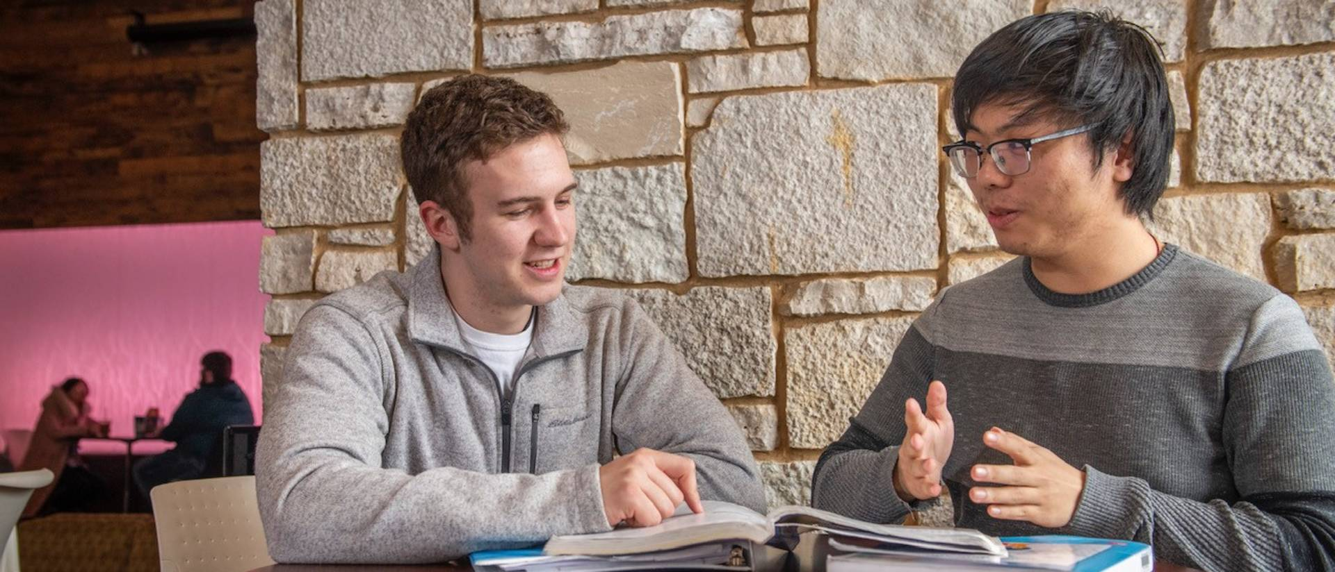 Noah Turecek (left) and Mingyang Qu meet to catch up on classes and life, but also to help each other build their language skills and their understanding of cultures that differ from their own.