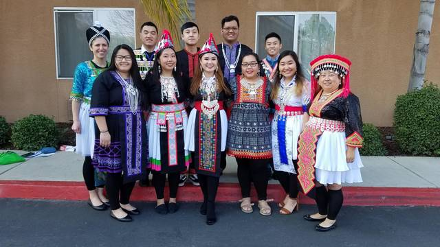 Students and faculty in traditional Hmong dress