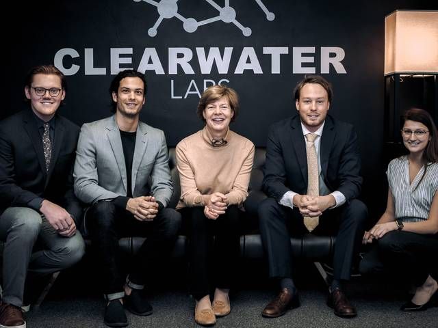 Senator Tammy Baldwin and Clearwater Labs team members