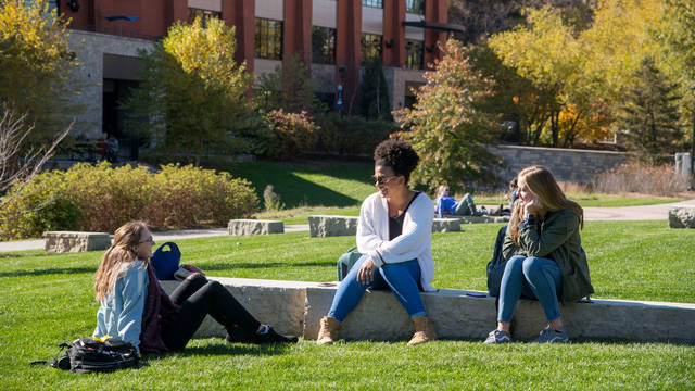 UW-Eau Claire students relax in between classes on the campus mall.