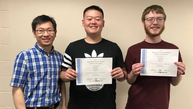 Vincent Biever, Eric Anderson, and Jinxuan Cong math team