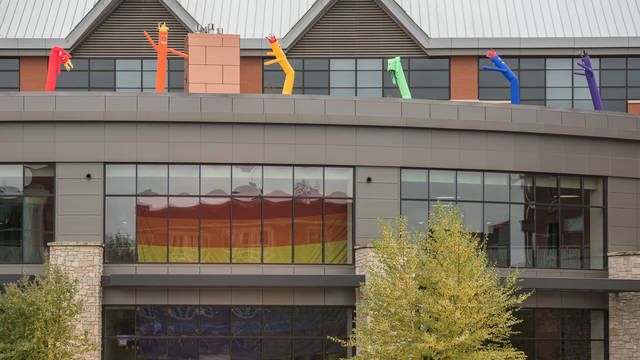 PRIDE flag and inflated people on Davies Center
