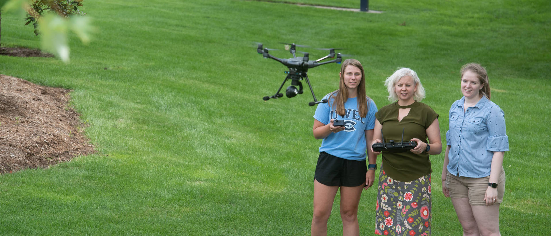 Dr. Patricia Cleary and students with drone