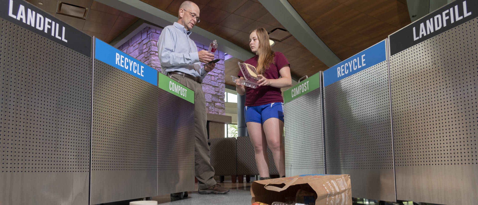 Dr. Scott Clark and senior Lily Strehlow are working to educate new students about how to properly separate their trash so it doesn't harm the environment.