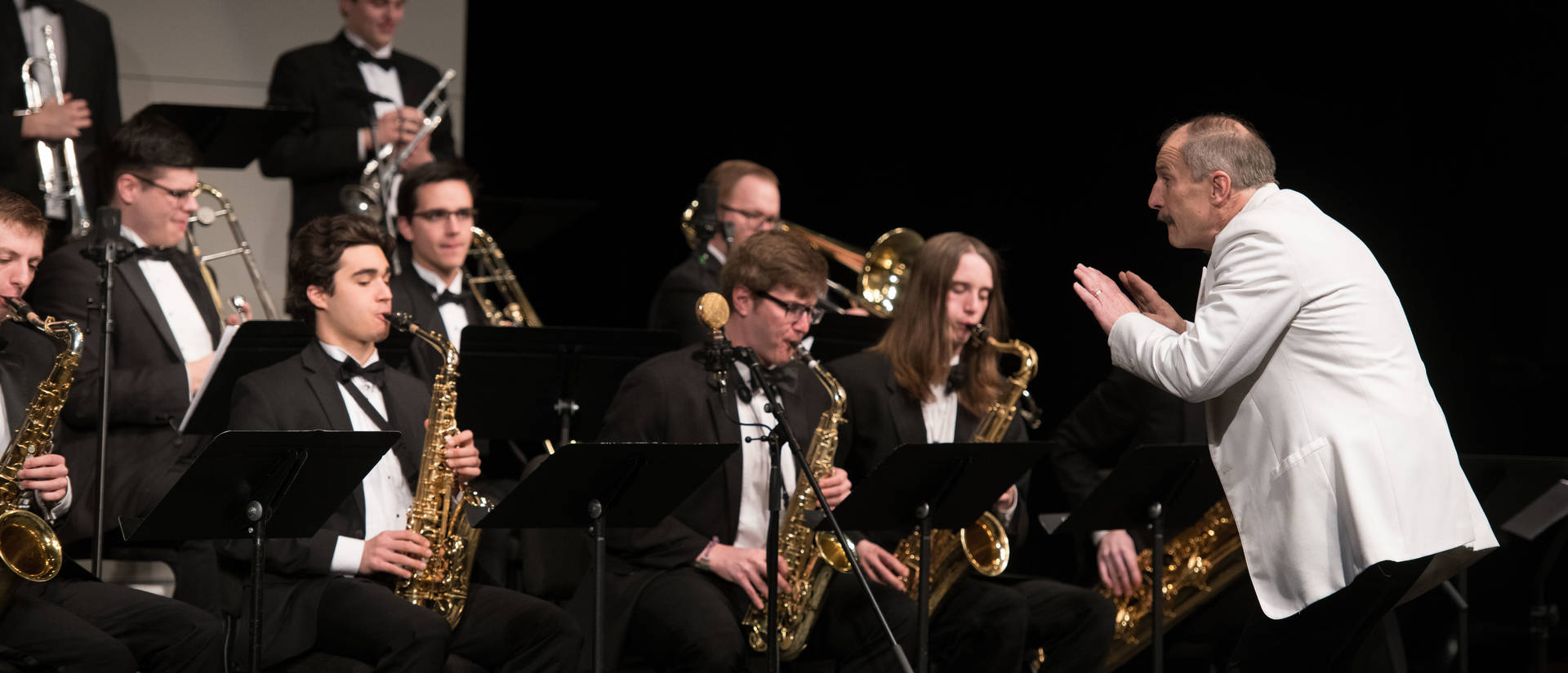 Bob Baca directing Jazz students on stage at Eau Claire Jazz Festival
