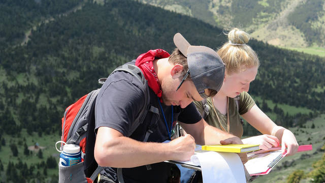 Dig It geology newsleter cover photo, students in mountain scene