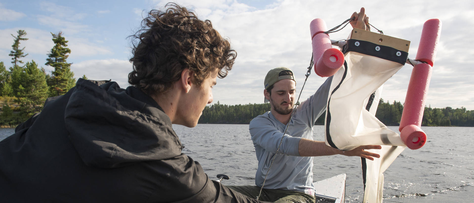UW-Eau Claire students Reed Kostelny (left) and Thomas Adams are part of a research team that found microplastics in earthworms, water and soil in the Boundary Waters.