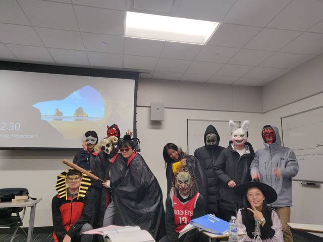 ESL 205 students in their Halloween costumes.